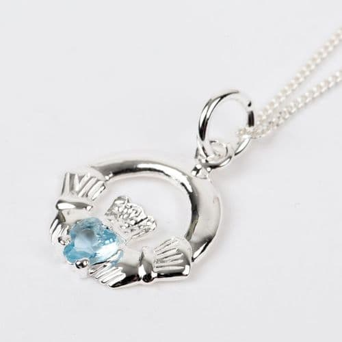 Sterling Silver Claddagh Birthstone Pendant with Blue Topaz CZ